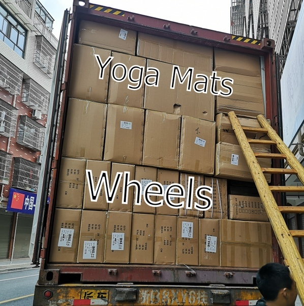 9: Container loaded with wheels & yoga mats
